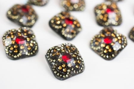 GUZIK PLASTIKOWY DIAMOND GOLD&RED