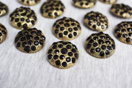 GUZIK METALOWY BLACK DIAMONDS ON GOLD